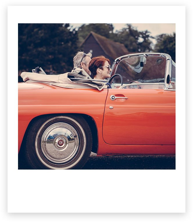 Couple in red convertible